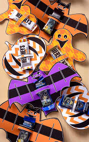 It's nice to download pages of free art, print them up, and make the holiday cuter with just a little bit of paper and double stick tape. Halloween Candy Bar Wrappers Free Printable Mod Podge Rocks