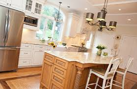 best countertop selection from colonial cream granite warm kitchen design with wrought iron chandeliers and