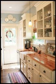 white country kitchen with butcher block. Plain Country White Cabinets Butcher Block Countertops Farmhouse Sink And Pretty Blue  Walls Kitchen Inside White Country Kitchen With Butcher Block C
