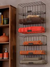 adorable wall mounted iron rail towel storage feature wooden cabinetry for apothecary bath storage in classic bathroom decors
