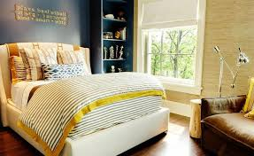 Exceptional Yellow And Blue Boyu0027s Bedroom Features A Navy Accent Wall Lined With A  Cream Wingback Bed Draped In An Orange Hermes Avalon Blanket Dressed In  Yellow And ...