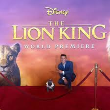 Aaron Benitez of Aaron's Animals and his cat Prince Michael at The Lion  King premiere. (He's a real cat, his eyes are digitally manipulated here.)  : celebswiththeirpets