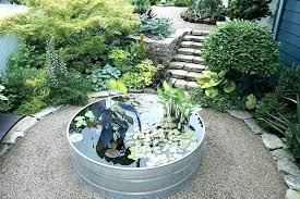 stock tank garden stone steps lead down from the entrance terrace to a circular around planter