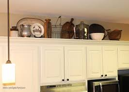Above Kitchen Cabinet Decorating Above Kitchen Cabinets Tuscan Style White Hood Grey