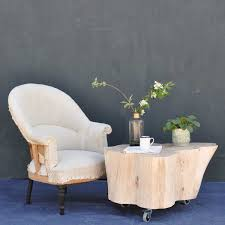 Decorative canvas covered wooden storage trunk style coffee table with wheels. Tree Trunk Coffee Table On Wheels In Bleached Natural Timber