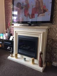 cream fireplace surround and electric fire with crystal and diamante detail