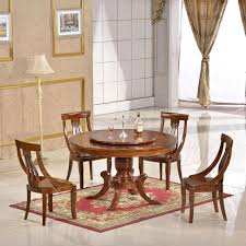 amazing bronw wooden dining table with rotating center