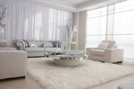 silver living room furniture. living room beige three seat sofa double sink beside timber glass wall archway brick pilars looking silver furniture