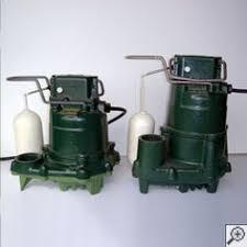 closeup of a zoeller® sump pump system a cast iron design and two cast iron zoeller sump pump systems