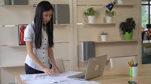 the creative office. Interesting Creative Asian Architect Standing In The Creative Office Agency And Drawing  Architectural Design On Wooden Table Plan Of Building Laptop Pencil Line With The Creative Office F