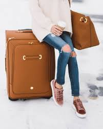 durable and stylish this joy mangano christie carryon luggage is made of rich affiant cognac leather paired with gold hardware perfect for the pro