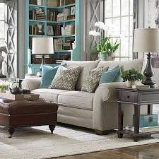 terrific brown and grey living room beige sofa square leater sofa stool beige rug brown wooden coffee table grey wall blue shelves