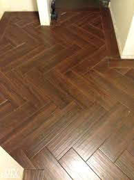 wood and tile floor tactacco