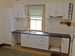 prepossessing flat pack laundry cupboards bunnings with additional nett flat packed kitchen cabinets pack on inside bunnings
