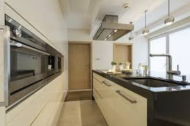 Another modern kitchen with a massive single-basin sink, sleek wall  cabinets, and