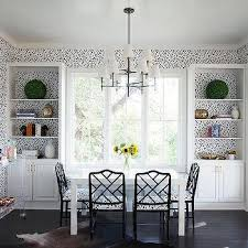 black and white dining room with white parsons dining table