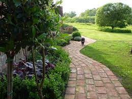 lay down a recycled brick path