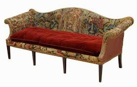 The camelback isn't just a historical, period sofa anymore and hopefully  the pictures below will prove it.