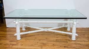 a vintage 1960s faux bamboo white lacquered cocktail or coffee table with rounded corner glass top