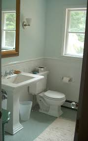 seafoam guest bath view of the kohler memoirs stately suite and white tile wainscot