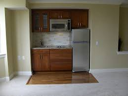 Kitchenette - replace one large drawer with a dishwasher. Rangehood under  the microwave?