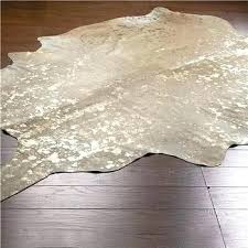 gold cowhide rug flecked metallic in living room on white