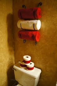 Christmas decorations in the guest bathroom: Wrap toilet paper with red  ribbon. What a