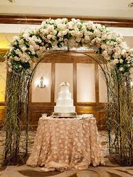 indoor wedding arches. repurpose the wedding arch after ceremony to create a stunning cake display indoor arches o