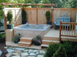 Outdoor Jacuzzi Corner Deck Hot Tub With Small Pergola And Vertical Privacy Fence