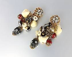 striking vintage clip earrings featuring black and red lucite beads mother of pearl chips and rhinestone rondelles in a chandelier drop design
