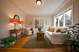 living room simple room designs gold metal table lamp dark brown wooden flooring white tile