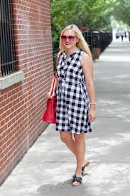 black and white dress with red accessories