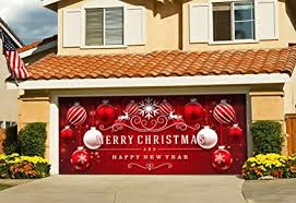 red and white ornaments on red holiday garage door décor