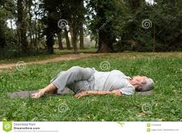older woman practicing yoga abroad