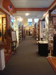 kress emporium. downtown asheville. this historic building houses and sells the artwork, about as diverse possible, of 80 local artists. kress emporium