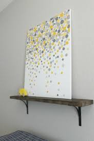 Easy DIY: gray and yellow dot painting. May try red and gray for the kids  bathroom. Lose the shelf.maybe a long canvas. for in the living room.