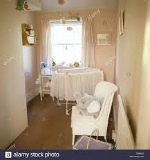 White Painted Wicker Chair In Babyu0027s Nineties Nursery Bedroom