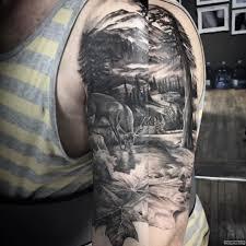 горы ели и олень тату на плече у парня добавлено иван вишневский