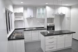 cabinet in kitchen design. white colour l-shaped kitchen cabinet with island in design