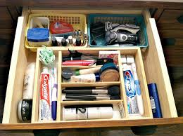 bathroom drawer organization: we use the bottom drawer for all our travel size toiletries and travel toiletry bags this might seem like a waste of space but we actually use our