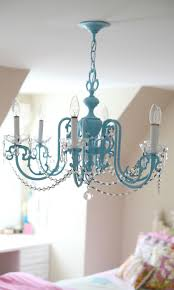 Check out this Girls Chandelier Makeover from Lindsay Wilkes of The Cottage  Mama. Makeover an