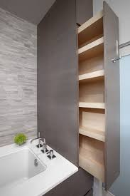 these crawl spaces and nooks between bathtub and wall can be creatively turned into organized storage