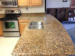 honey oak cabinets with black granite countertops and noble