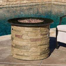 hoonah 32 in x 24 00 in round stone gas fire pit with black top
