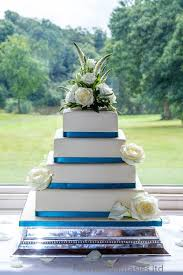4 tier square wedding cake with fresh flowers
