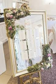 elegant mirrored seating chart dripping with greenery and flowers a wedding diy plan ideas wedding seating chart