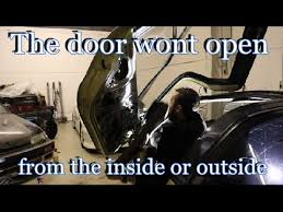 how to fix a car door mechanism that wont open from either inside or outside