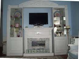 fireplace surround found on craigslist was a dirty yellow i spray painted it white with krylon