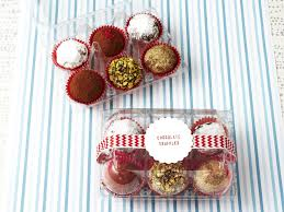 chocolate truffles in clear egg carton