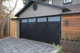 Garage With Black Doors Windows